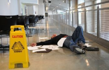 Man Lying on Floor After Slip and Fall